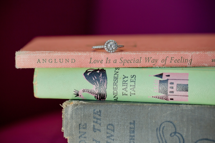 close up photo of engagement ring on books