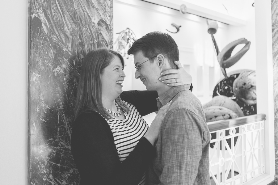 black and white photo of engaged couple looking at each other