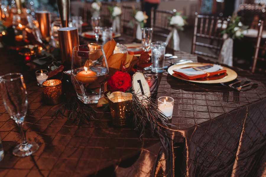 brown and copper table setup at grange insurance audubon center wedding