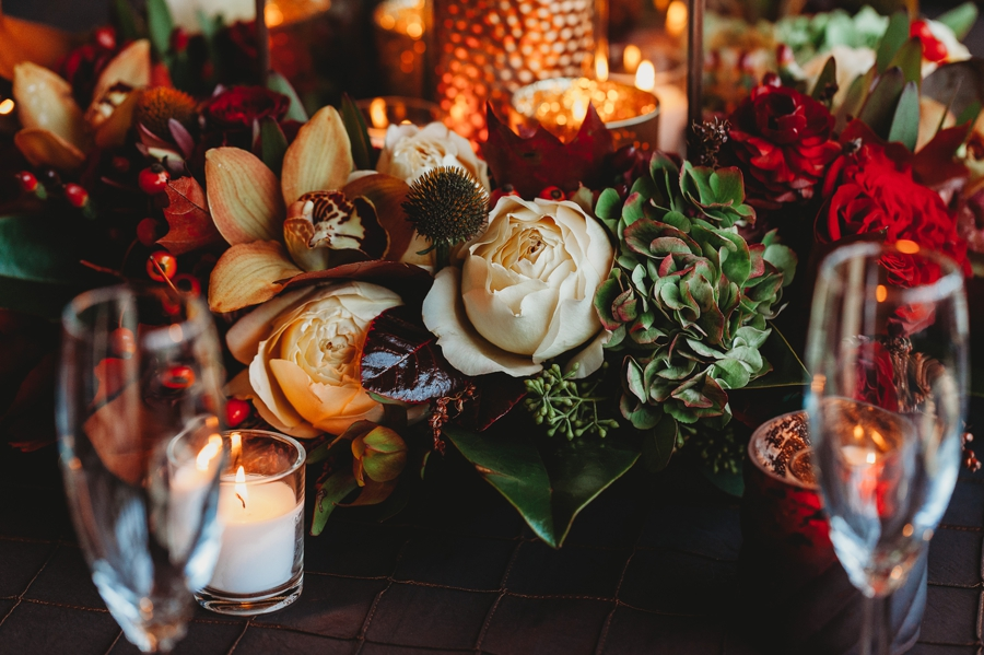 close up photo of fall floral arrangements at wedding