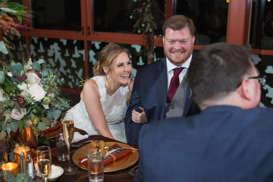 married couple laughing at father of bride toast