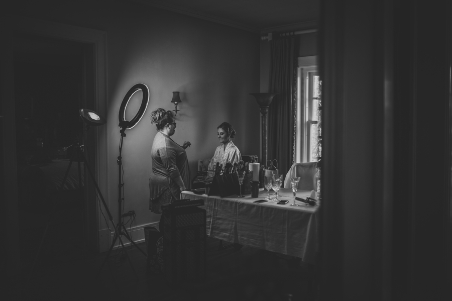 black and white photo of bride getting makeup