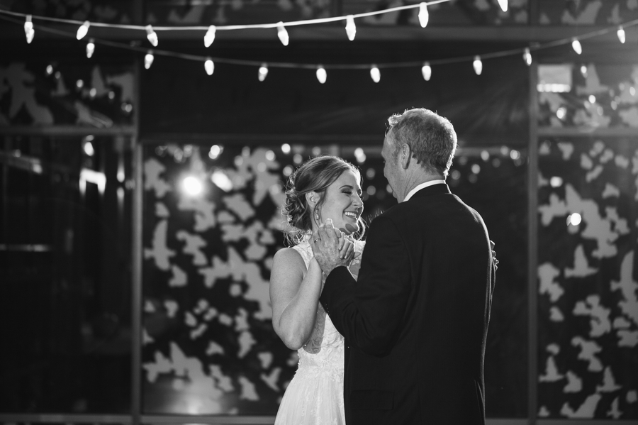 black and white photo of father daughter dance at grange insurance audubon wedding