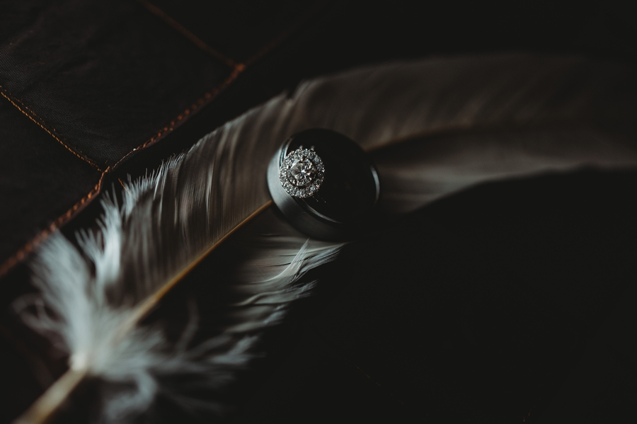 wedding rings on feather at grange audubon wedding