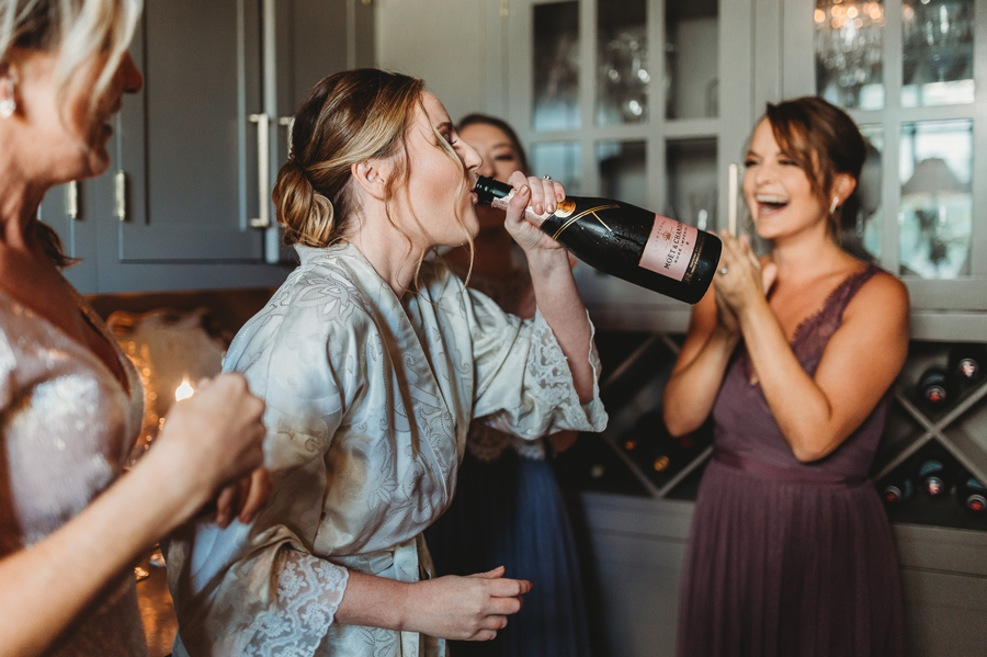 bride drinnking champagne from bottle