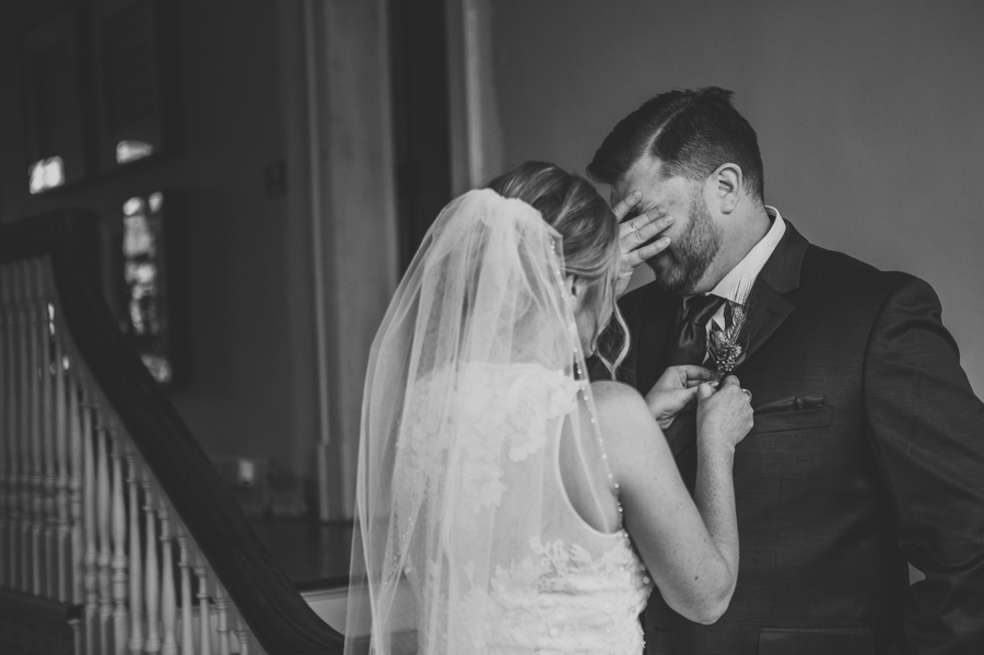 black and white photo of grooms reaction to first look