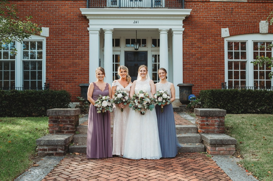 bride with bridesmaids at grange insurance audubon center wedding