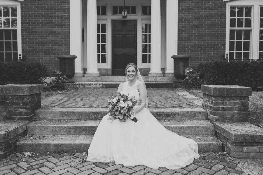 bride sitting on brick steps
