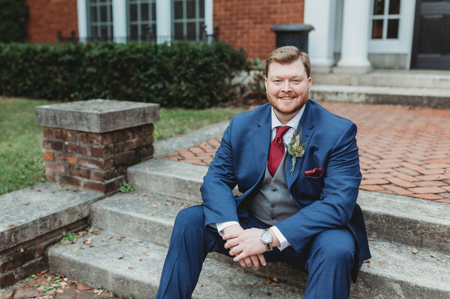 groom sitting on steps