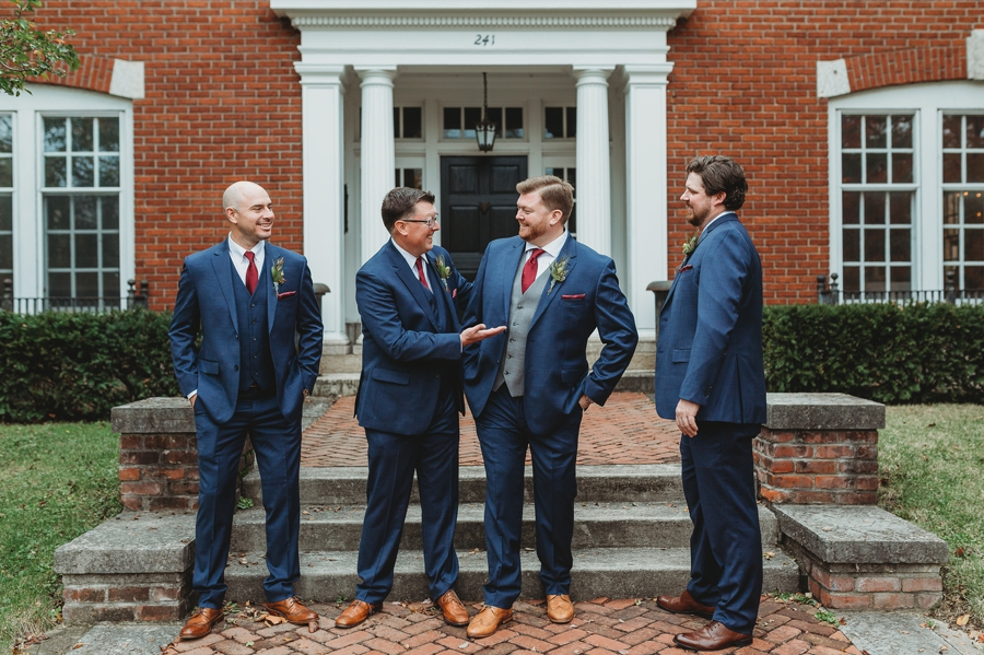 candid groomsmen photo at grange insurance audubon center wedding