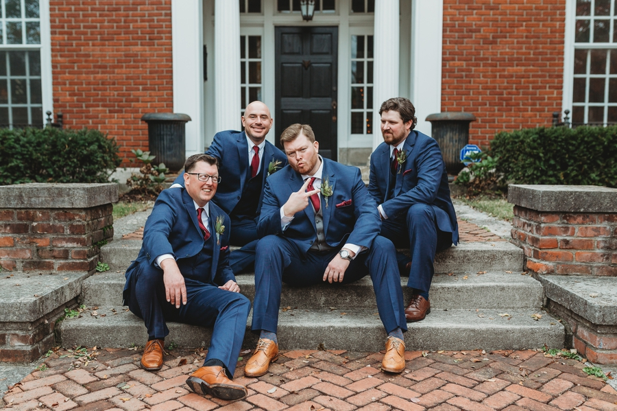 groomsmen posing on brick steps