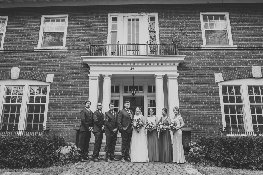 wide black and white photo os wedding party at grange insurance audubon center wedding