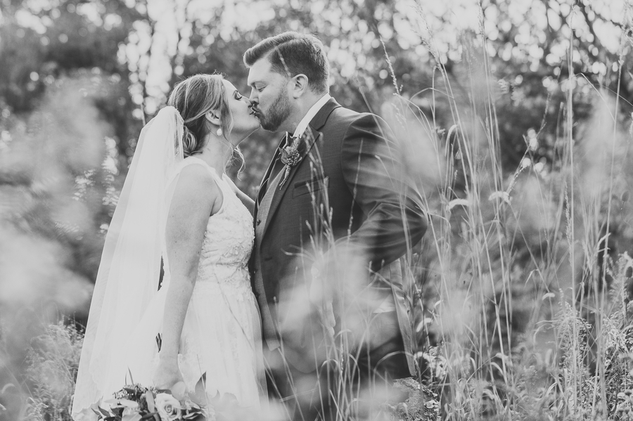 black and white photo of married couple kissing at grange audubon wedding