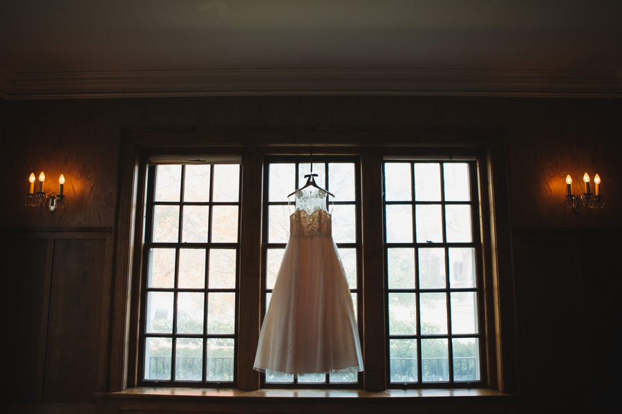 wide photo of wedding dress in victorian home