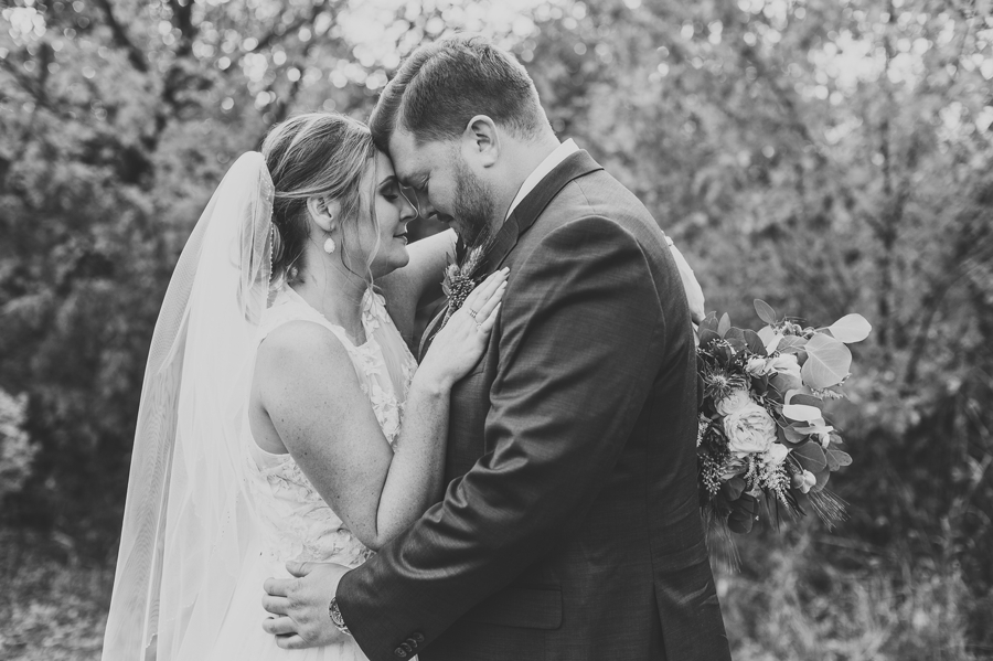 married couple with foreheads together at grange insurance audubon center wedding