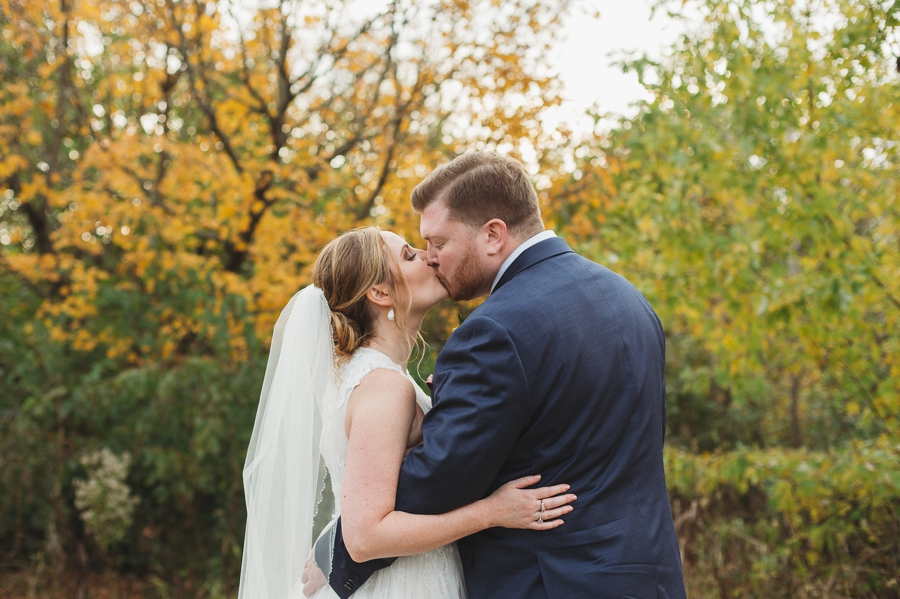 married couple kissing at fall wedding in columbus, ohio