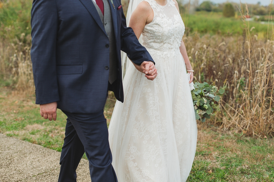 close up photo of married couples hands while walking