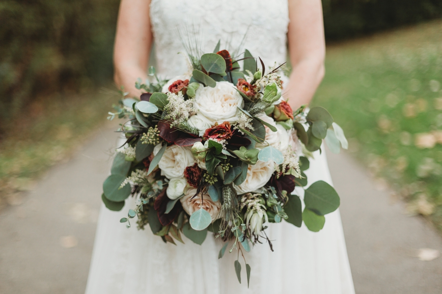 green white and rust colored wedding bouquet