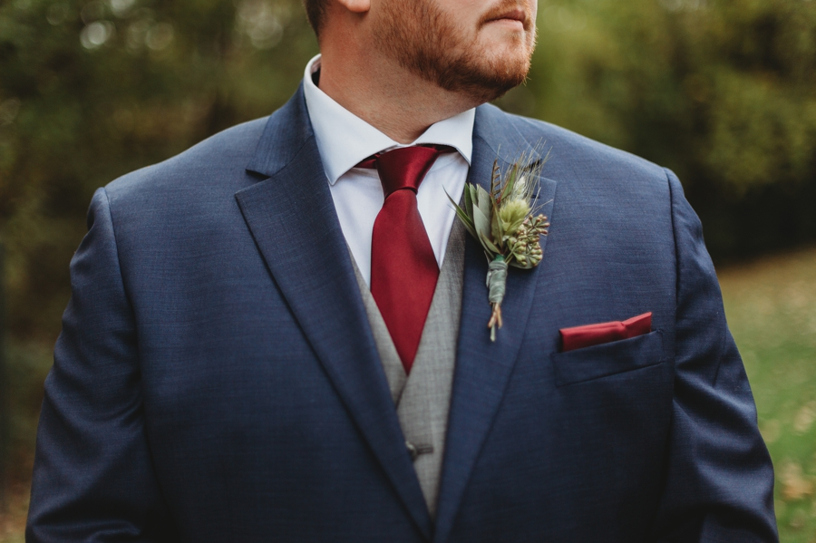 close up photo of grooms burgundy tie at grange audubon