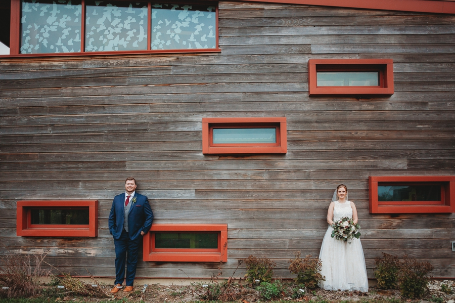 wide photo of married couple on side of grange insurance audubon center wedding