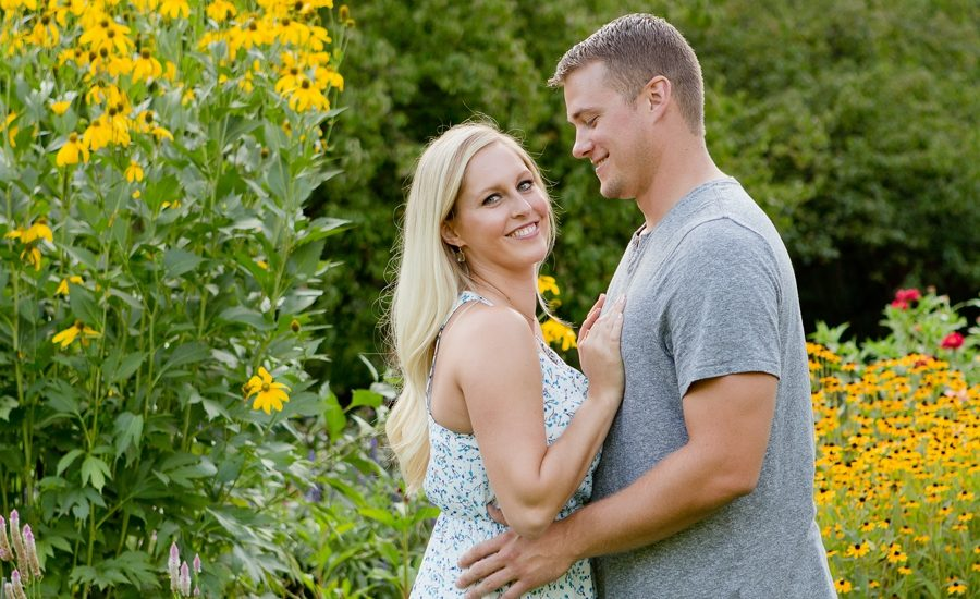 engaged couple in front of black eyed susans