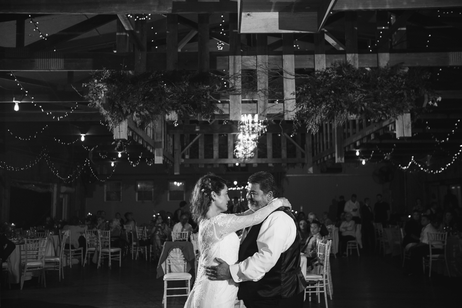 black and white photo of father daughter dance at jorgensen farm