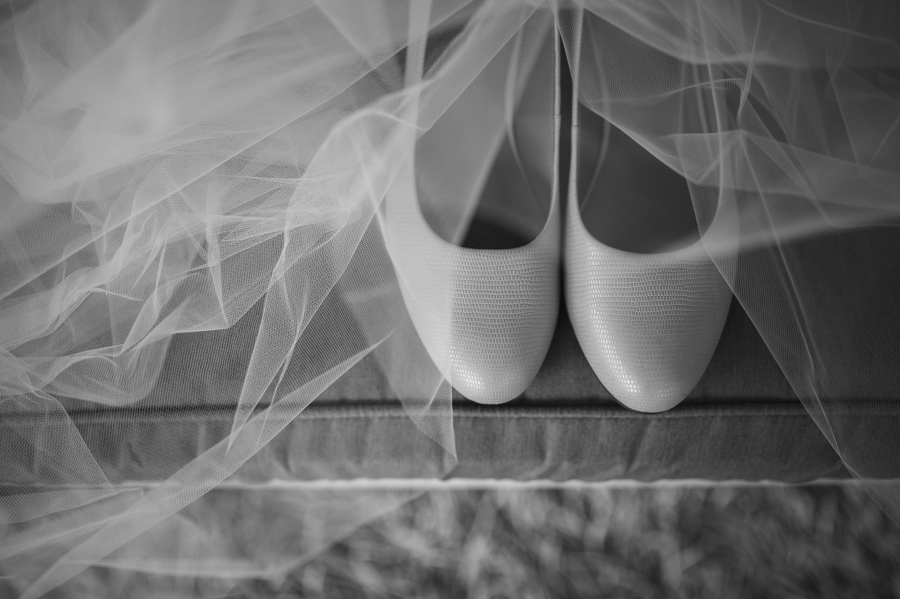 black and white photo of brides shoes