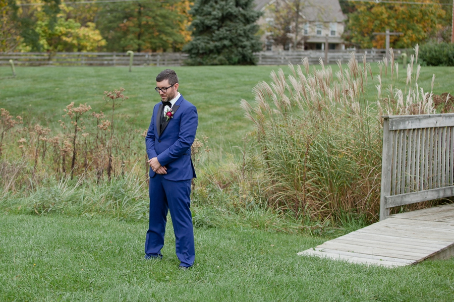 groom waiting on bride for first look