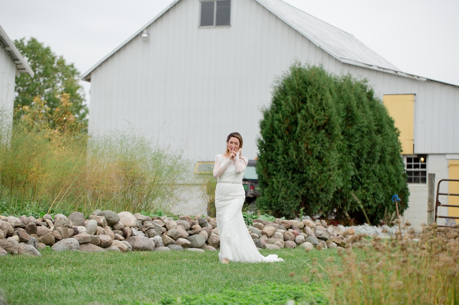 bride sneaking up on groom for first look at jorgensen farm