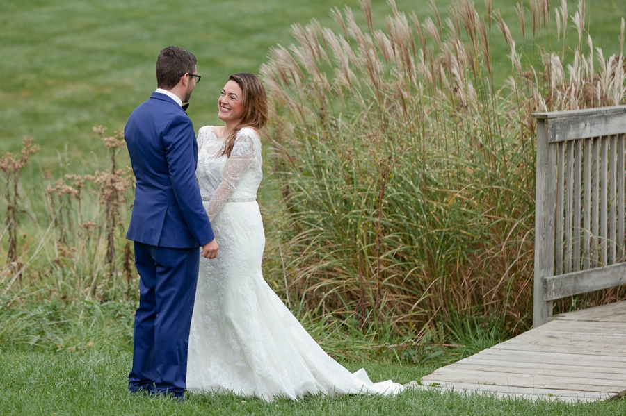 bride smiling at groom during first look