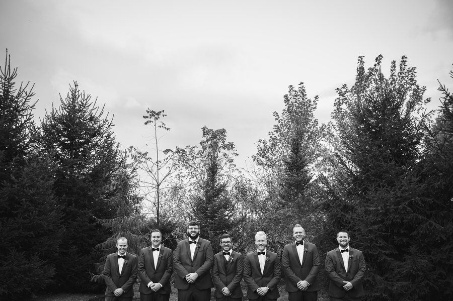 black and white photo of groom with groomsmen at jorgensen farm