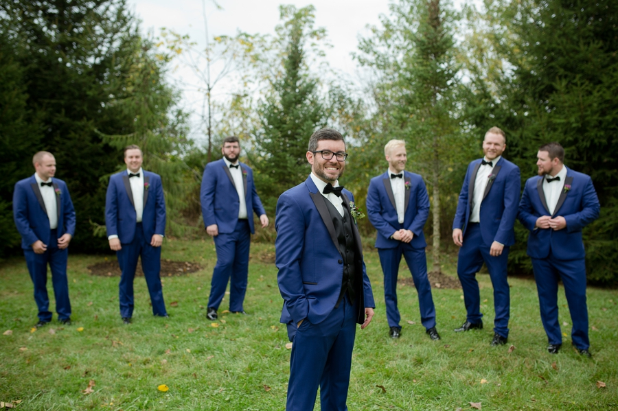 groom in foic with groomsmen in background