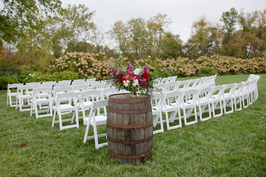 close up of wine barrel and chairs at jorgensen farm ceremony