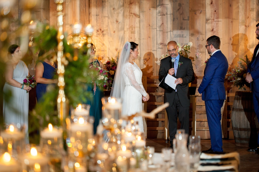 wedding officiant praying with couple at ceremony
