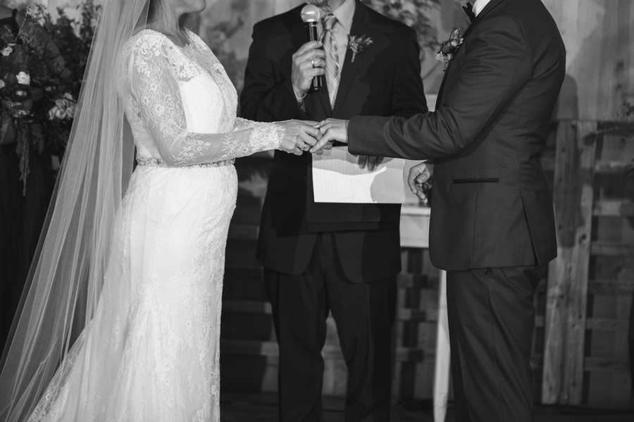 close up of ring exchange at wedding ceremony