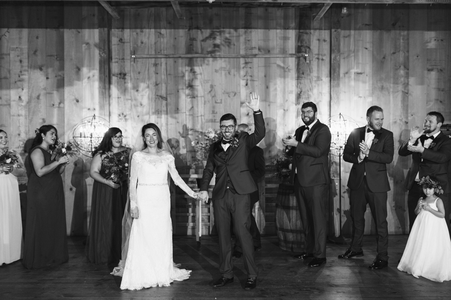 black and white photo of bride and groom announced as husband and wife