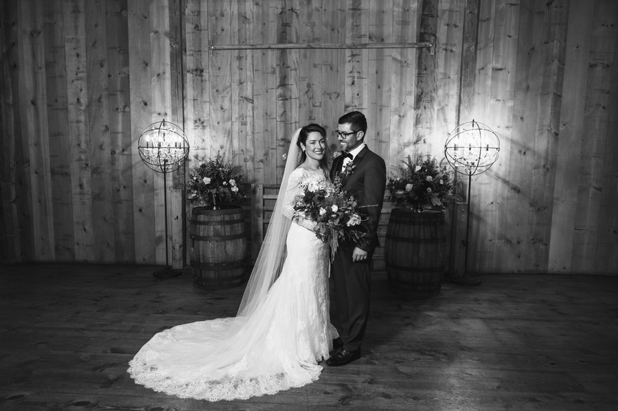 black and white photo of bride and groom at jorgensen farm wedding