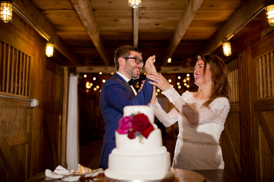 groom taunting bride with cake in the face at jorgensen farm