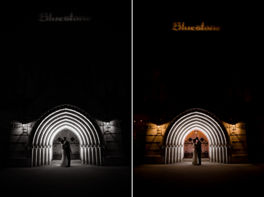 wide night photo of bride and groom at the entrance of the bluestone