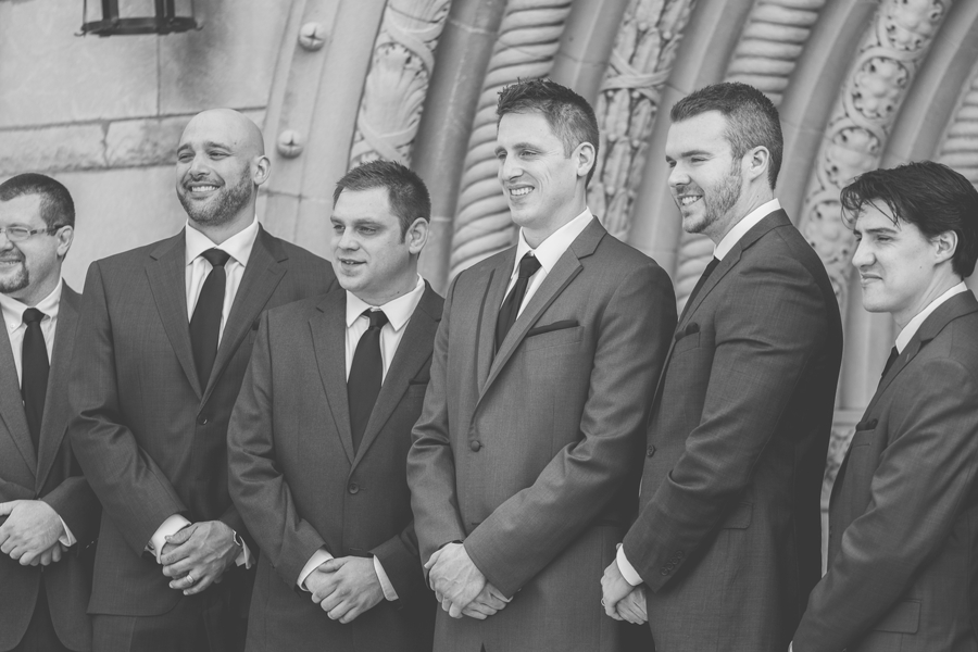 black and white photo of groom and groomsmen at columbus bluestone