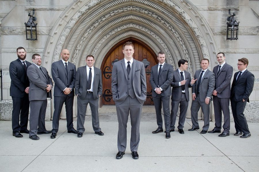 candid photo of groom and groomsmen at the bluestone