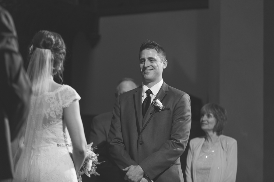 black and white photo of the groom at the bluestone