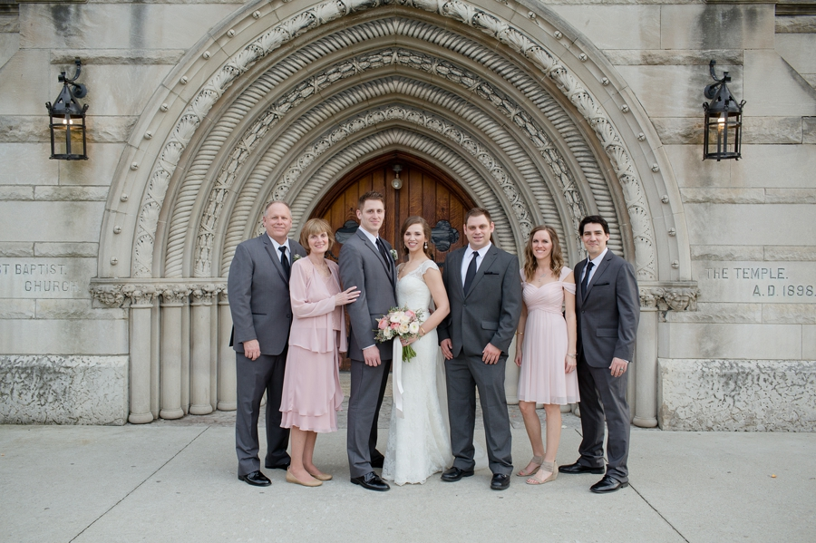 wide photo of family at the bluestone entrance