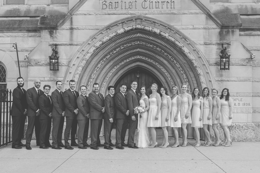 black and white large wedding party photo at the bluestone