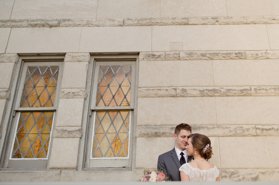the side of the bluestone building with bride and groom