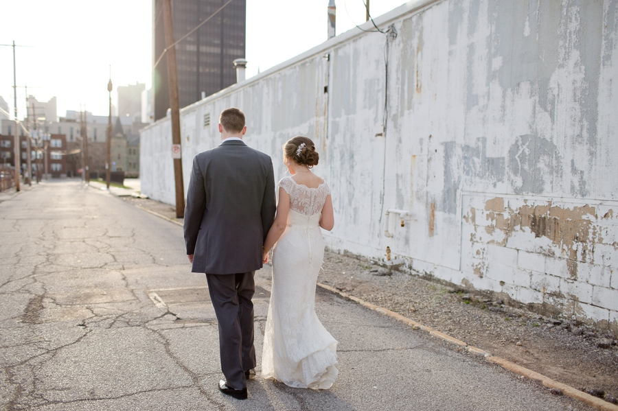 bride and groom walking in the alley of the bluestone