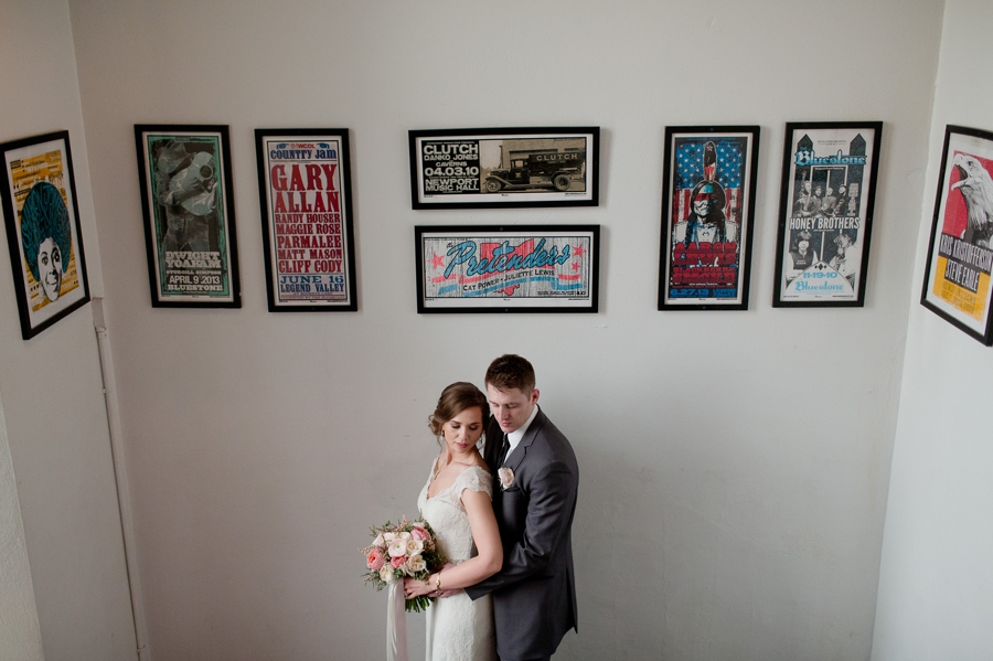 bride and groom pose with artwork at the bluestone