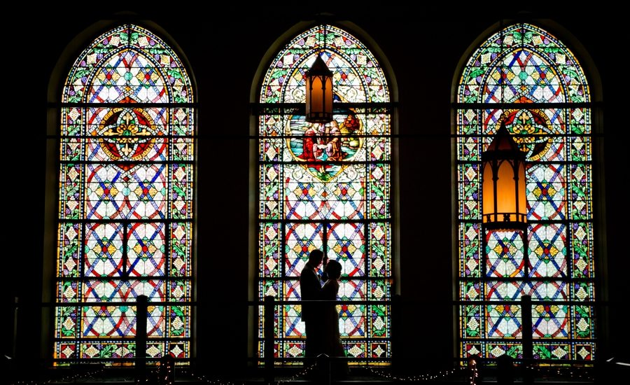 silhouette photo of bride and groom at the bluestone