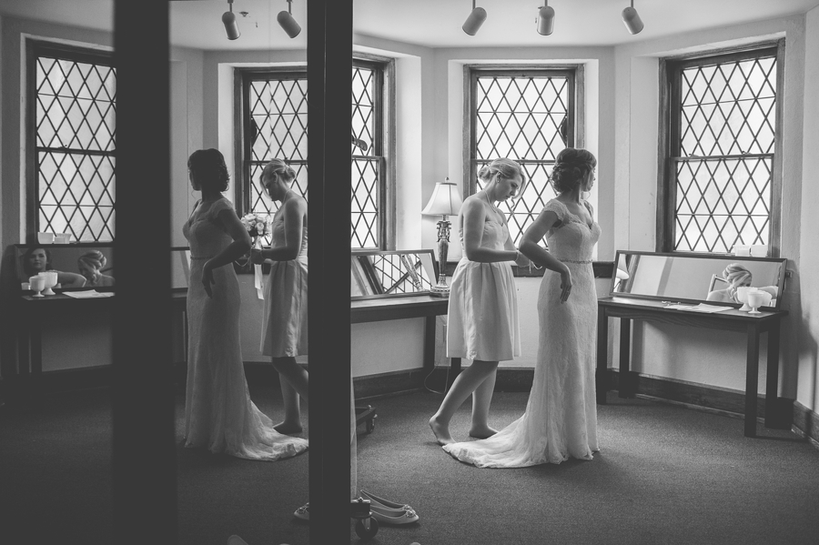 reflective black and white bride getting dressed at the bluestone