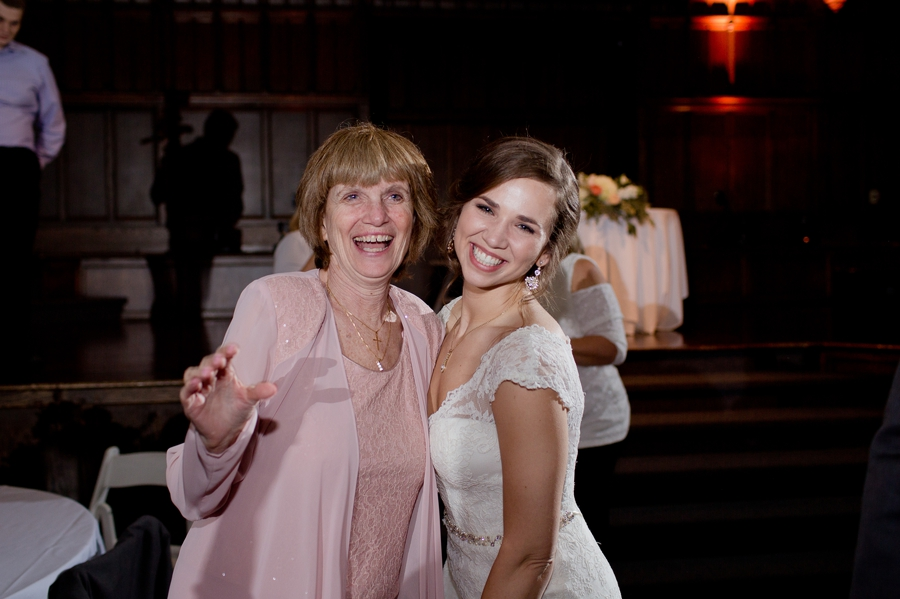 bride and mother in law smiling on dance floor
